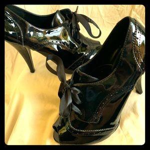 Delicious brand black patent retro booties.
